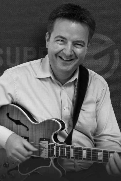 Michael Vochezer – SUPERGAIN - Musiklehrer in München